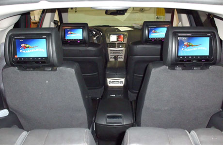 in-dash television, back seat video, portable video system, auto video installation, back seat car tv, mobile car gaming, mobile video installations, back seat video, auto monitors, car truck television